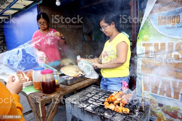 Street food vendor sells assorted grilled and fried pork innards in a picture id1205851850?b=1&k=6&m=1205851850&s=612x612&h= yixlatlumr4gjvtec ekeemkgpqeoaaeqojhgxzbtq=
