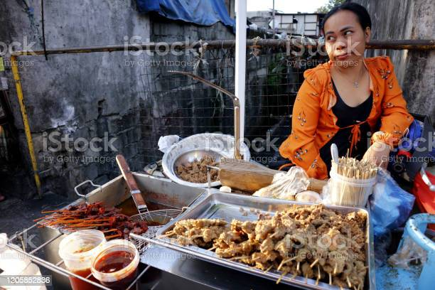 Street food vendor sells assorted grilled and fried pork innards in a picture id1205852836?b=1&k=6&m=1205852836&s=612x612&h=yupjb9r6mzqka9n0pntisudepbhqiaryvmd9ldx35s0=