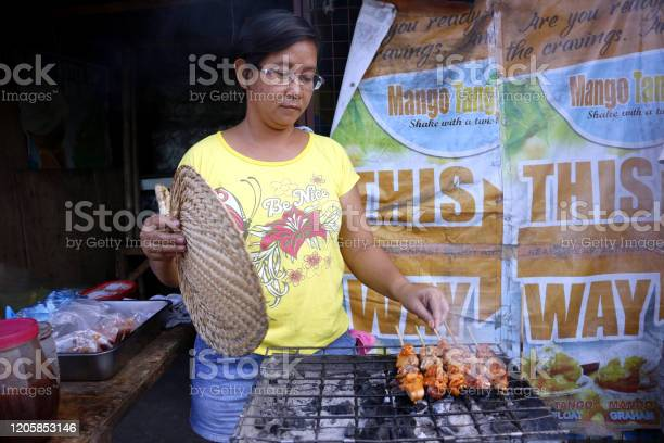 Street food vendor sells assorted grilled and fried pork innards in a picture id1205853146?b=1&k=6&m=1205853146&s=612x612&h=bhu382i7euybdibhfg k2fnz uo5osfjbc86ua5tuno=