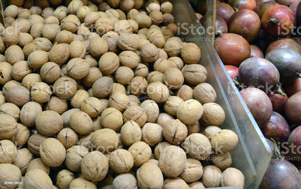 Street food with longan or dragon eye fruit and various fresh vegetables for sale at Asian market in China stock photo