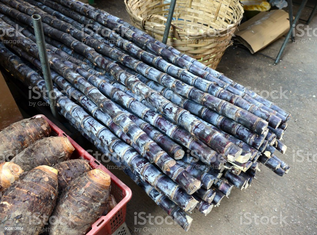 Street food with sugarcane and various fresh vegetables for sale at Asian market in China stock photo