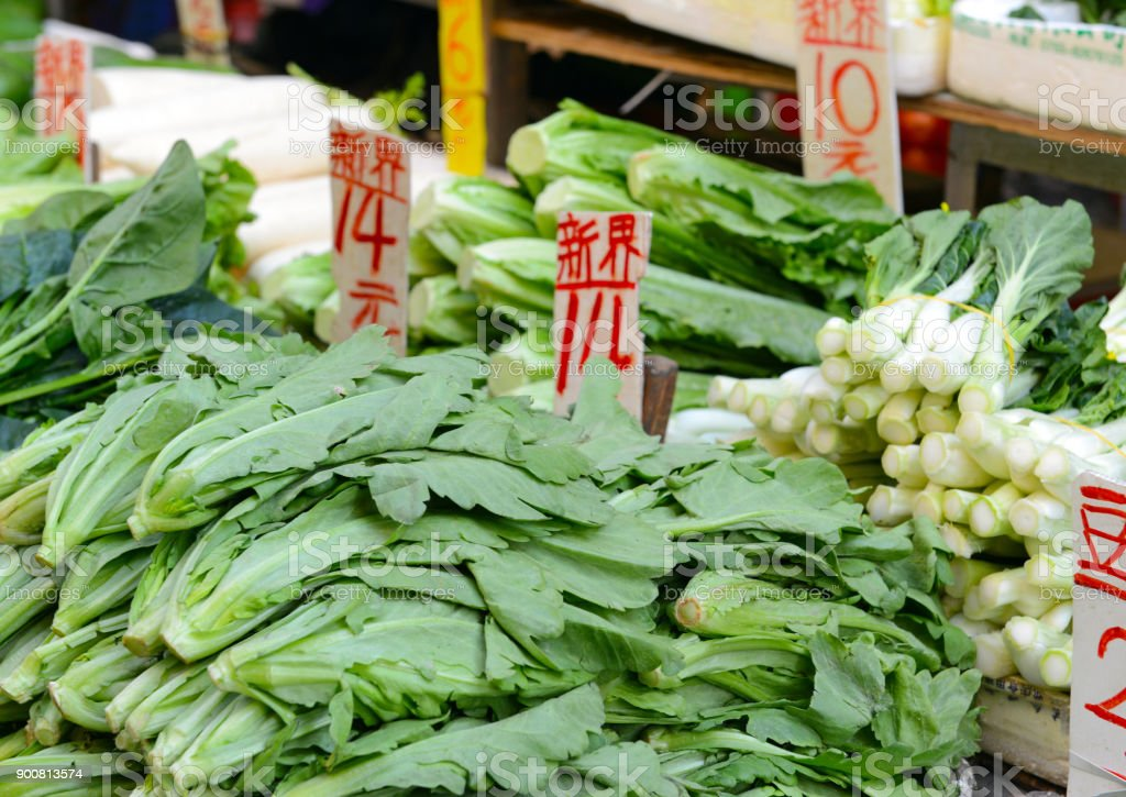 Street food with various fresh vegetables for sale at Asian market in China stock photo