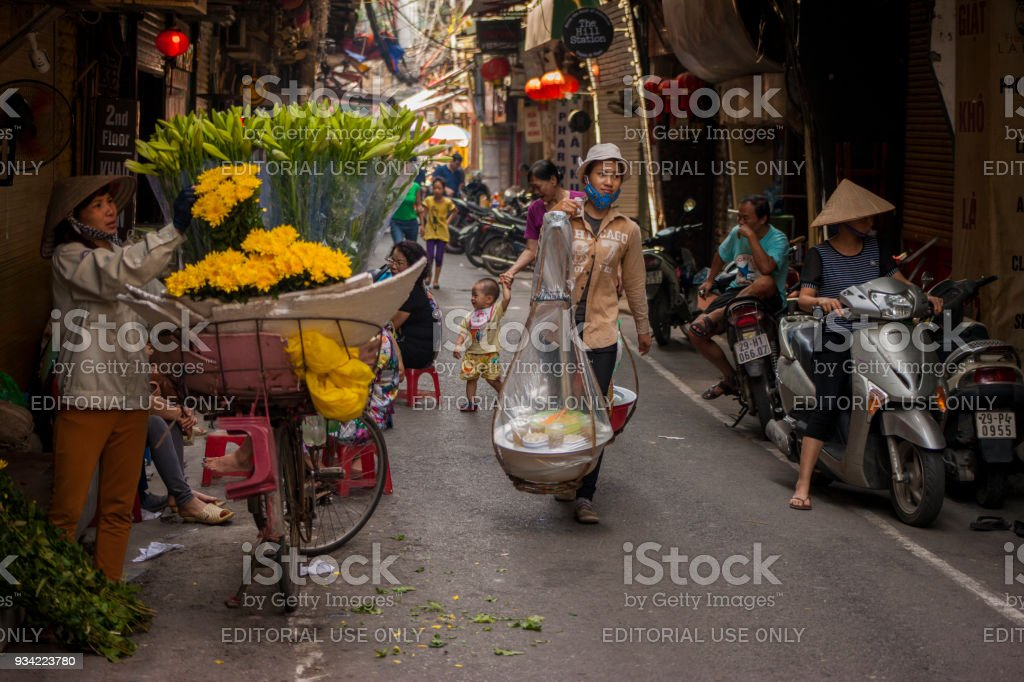 Street fruit vendors through the streets of Hanoi, Vietnam stock photo