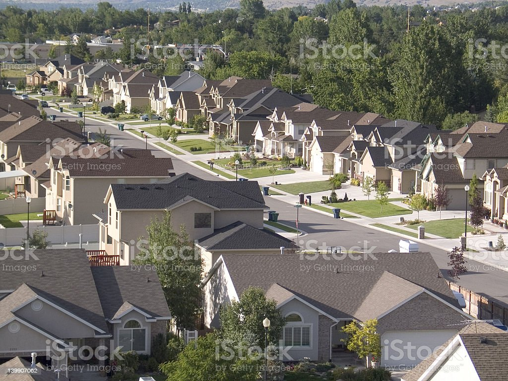 A street full of homes in a suburban neighborhood stock photo