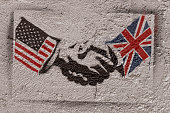 Stencil graffiti representing the agreement of two countries (USA - ENGLAND ). Photographer's own design.