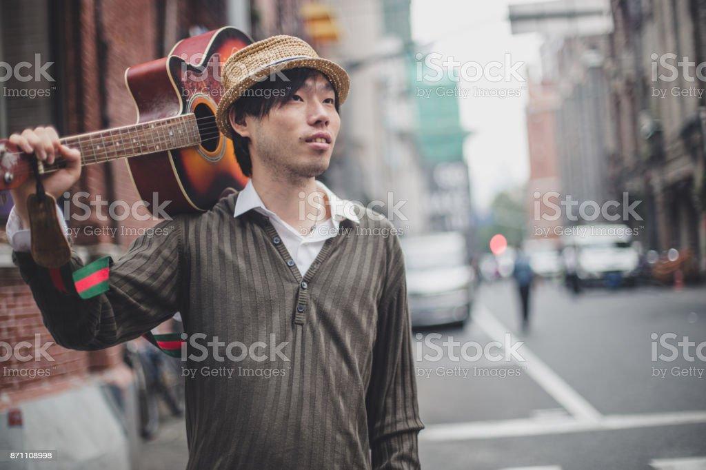Street guitar player stock photo