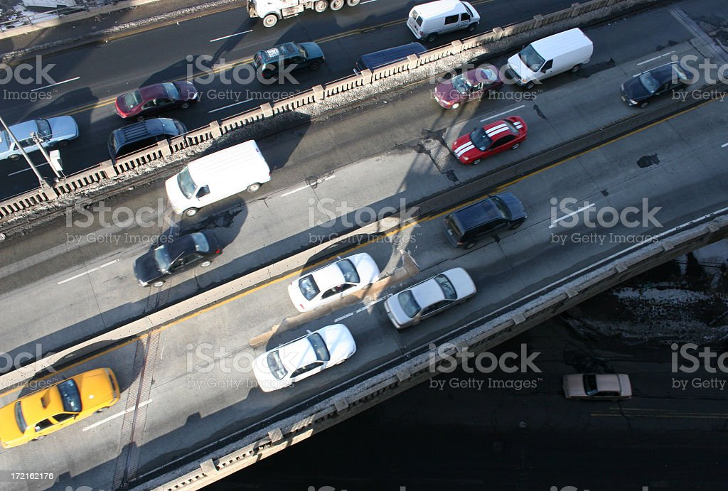 Street half full of traffic with different styles of cars stock photo