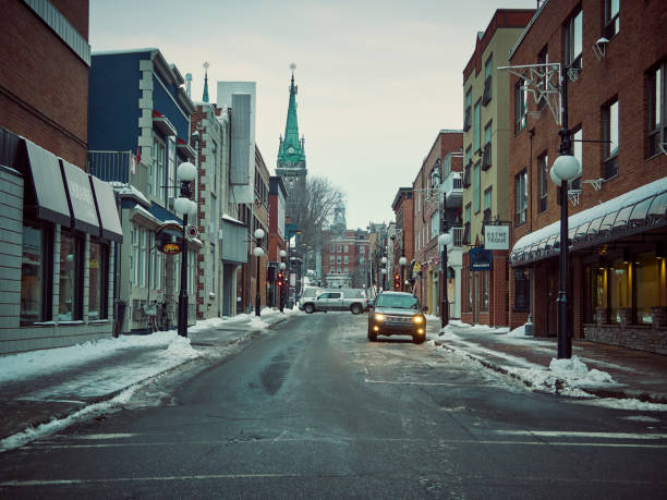 A street in a city center in winter. stock photo