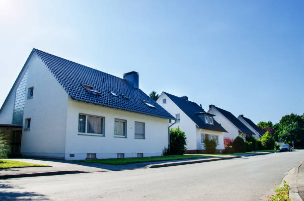 Street in a residential area with cottages stock photo