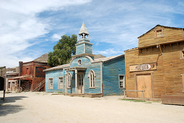street in american western town - western town stock photos and pictures