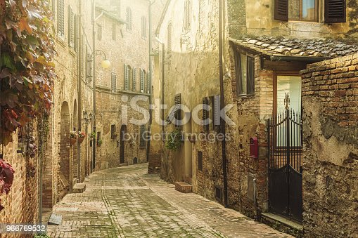 istock Street in an old italian town in Tuscany 966769532