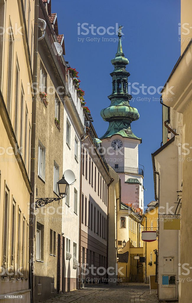 Street in Bratislava old town, with view on Michael Gate stock photo