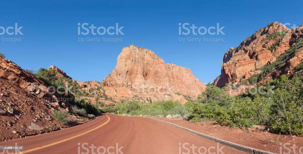 Street in Canyon with mountain range in Zion National Park Utah USA stock photo