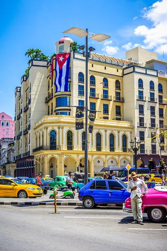 July 31, 2018 - La Havana, Cuba: taxi driver and vintage cars in Old Havana streets, Cuba
