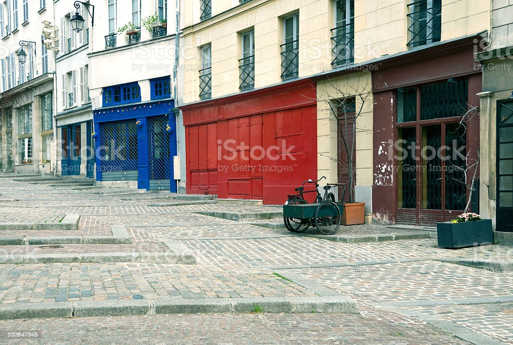 Street in La Marais with shops and apartments stock photo