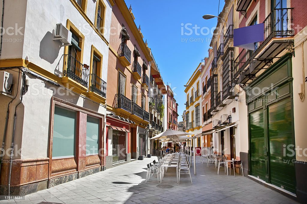 Street in old part of Seville town, Spain. stock photo