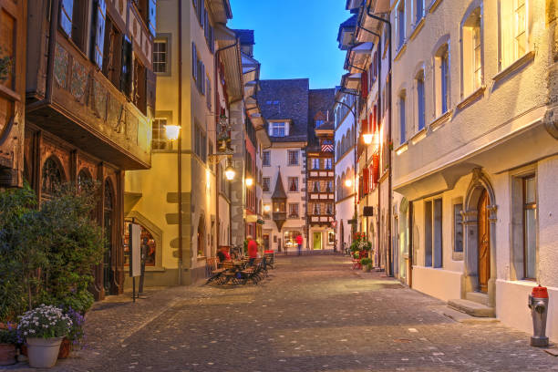 Street in old town of Zug, Switzerland Night scene of a street in old town of Zug, Switzerland. zug stock pictures, royalty-free photos & images