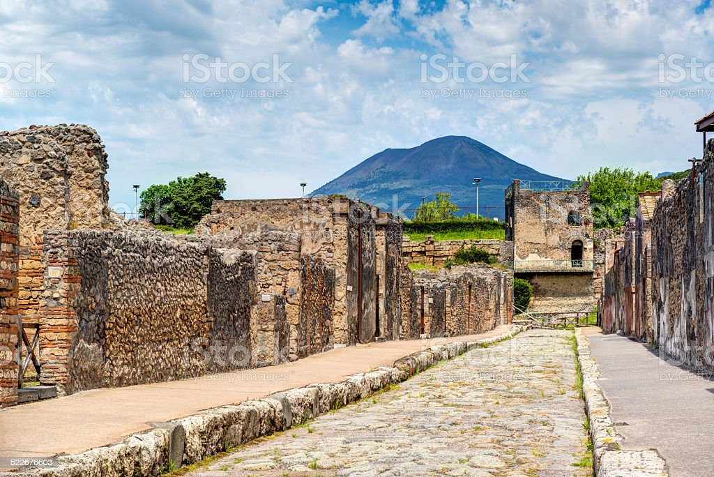 Street in Pompeii overlooking the Vesuvius, Italy royalty-free stock photo