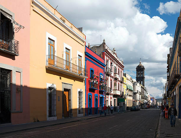 Street in Puebla in Mexico Puebla, Mexico - January 10, 2015: People walking down a colorful street in downtown Puebla. puebla state stock pictures, royalty-free photos & images