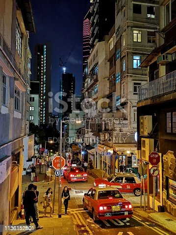 People at night  walking on a street in Soho, a lively nightlife area located in Central and bordering between Lan Kwai Fong and Sheung Wan. Hong Kong island