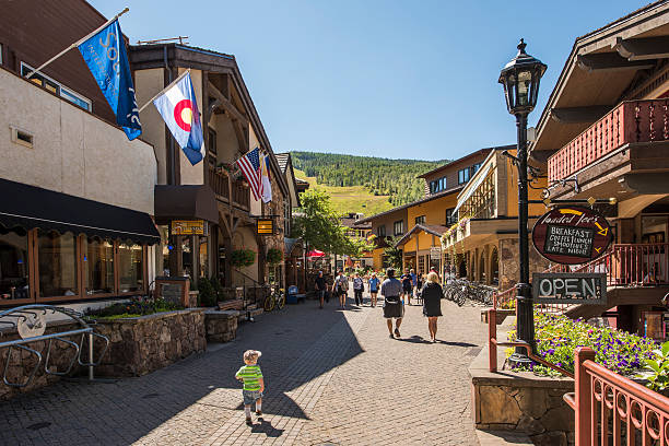 Street in Swiss style at resort town of Colorado Vail, USA - September 10, 2015: Street in Swiss style at resort town of Colorado with people vail colorado stock pictures, royalty-free photos & images