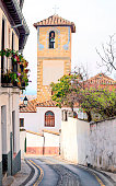 Sloping street in the spanish city of Granada in a sunny day