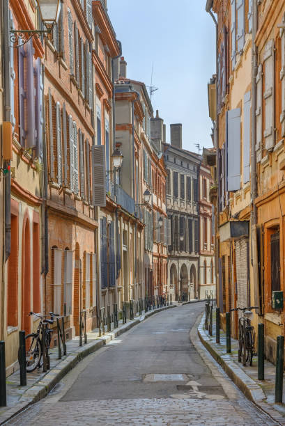 Street in Toulouse, France Narrow street in Toulouse historical center, France narrow stock pictures, royalty-free photos & images