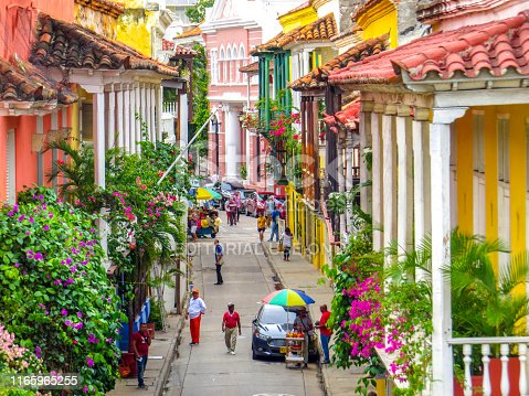 Street in walled city in Cartagena Colombia with people walking in the walled city and old town on July 21/2019  (note attached)