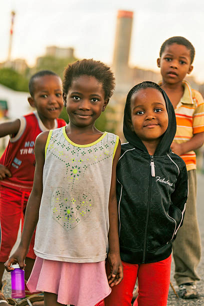 street kids in johannesburg at sunset - disinherit stock pictures, royalty-free photos & images