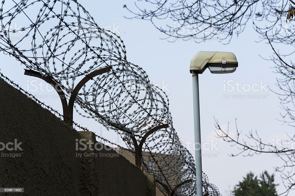 Street Lamp Beside Barbed Wire Fence Stretched Around Prison Walls ...