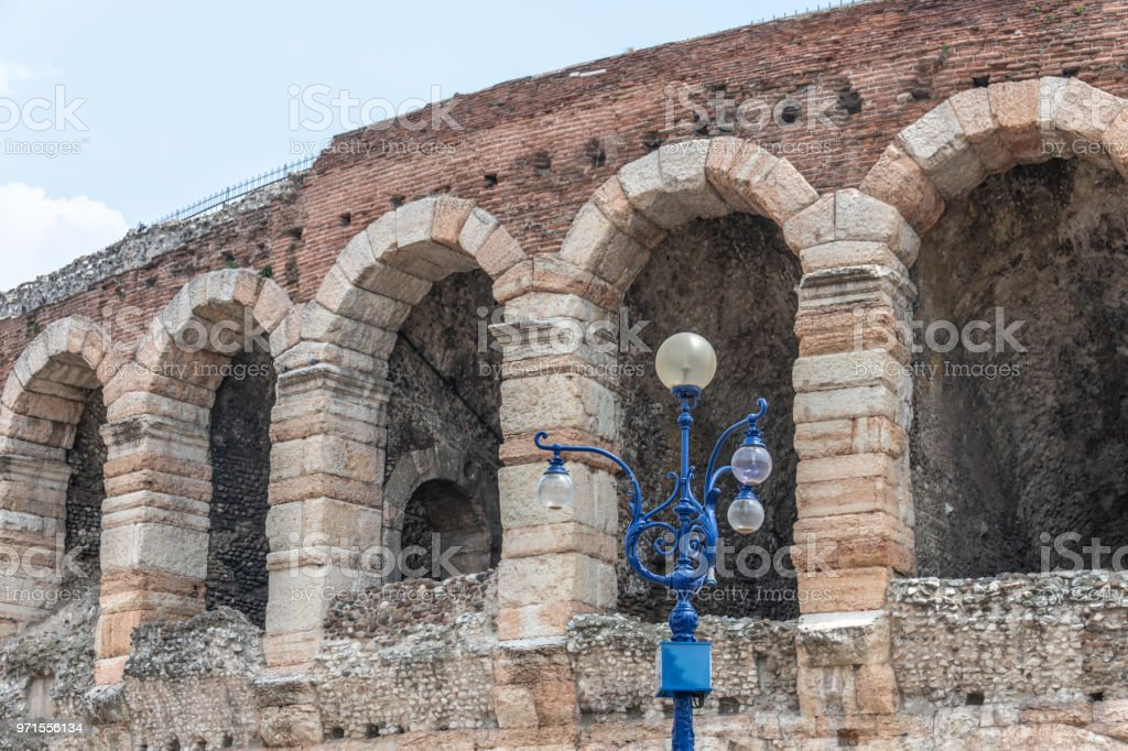 Street lamp by ancient Arena in Verona, Italy stock photo