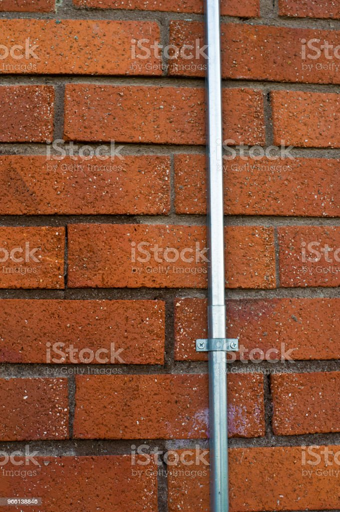 Street Lamp Cable Conduit On Red Wall - Royalty-free Alemanha Foto de stock