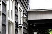 Street lamp lit at night in urban street, technology