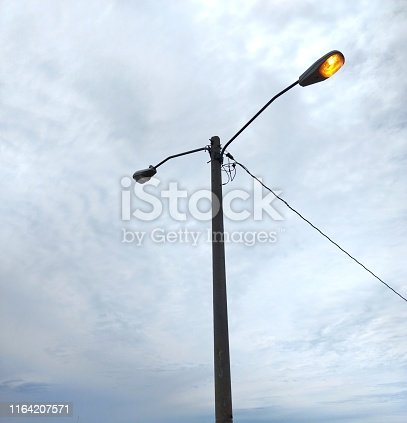 istock Street lamp on cloudy day 1164207571