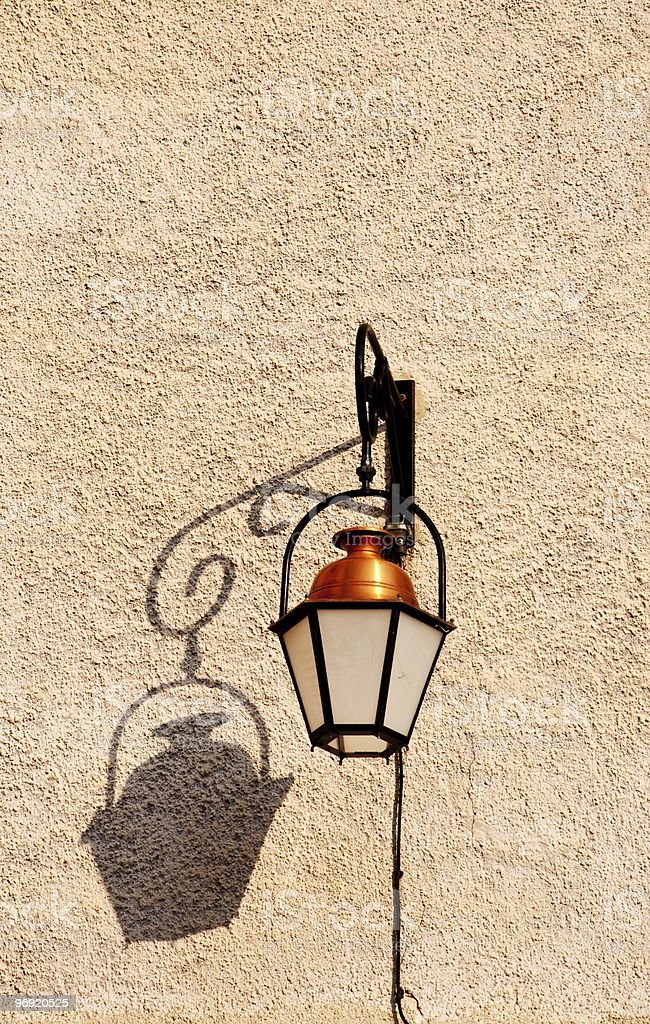 Street lamp on old wall royalty-free stock photo