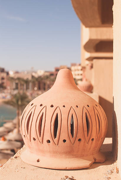 street lamp on the balcony at sunny day with beach - calabria map foto e immagini stock