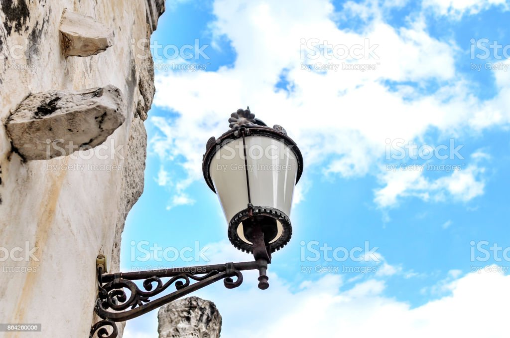 Street lamp on the facade of the house. royalty-free stock photo
