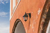 Street lamp on orange wall, Santorini Greece