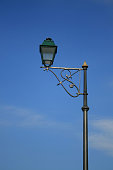 Green street lamp and blue cloudy sky