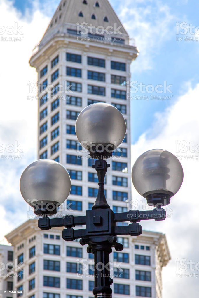 Street lamp with Smith Tower in Background, Seattle, WA. stock photo