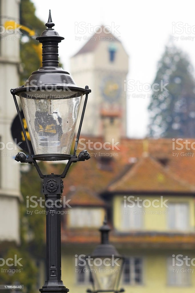 street lamps against background of ancient tower, Lucerne. royalty-free stock photo