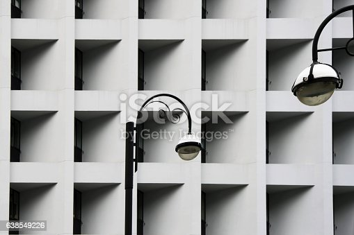 istock Street lamps against Modern abstract urban building. Detailed geometric black 638549226