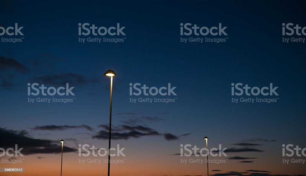 Street lamps and dusk horizon stock photo
