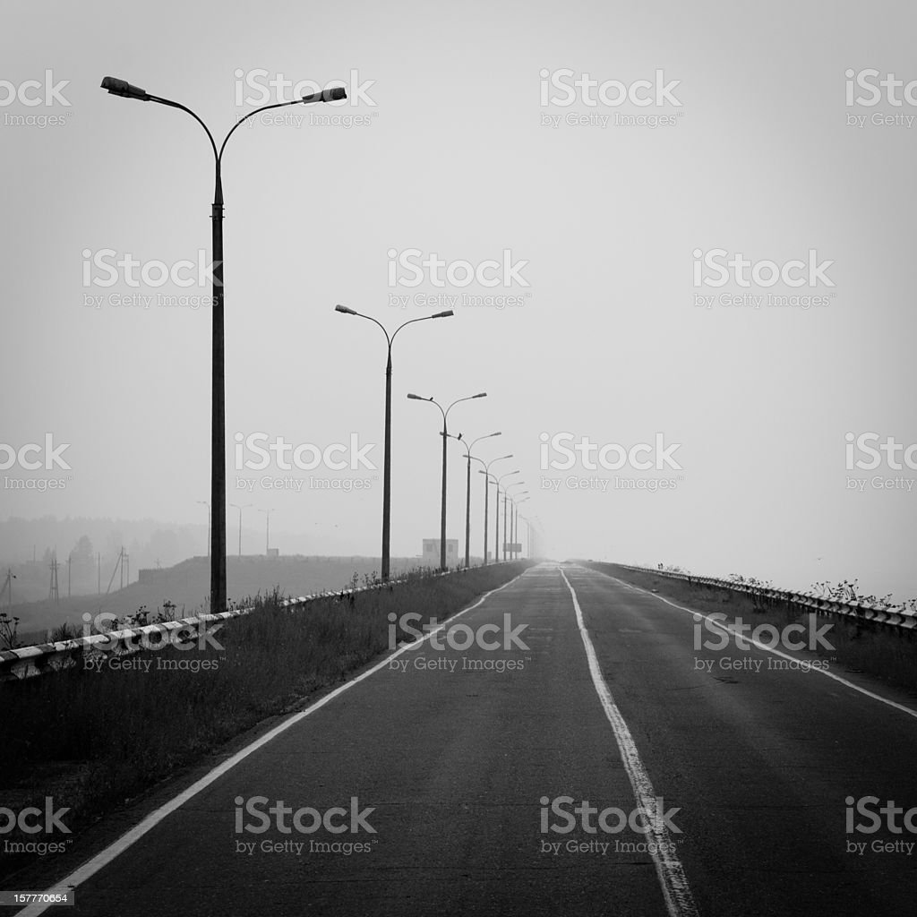 Street lamps near highway  Black And White Stock Photo