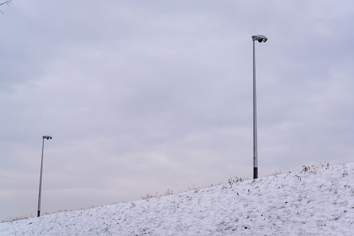 Street lamps on the embankment in snow