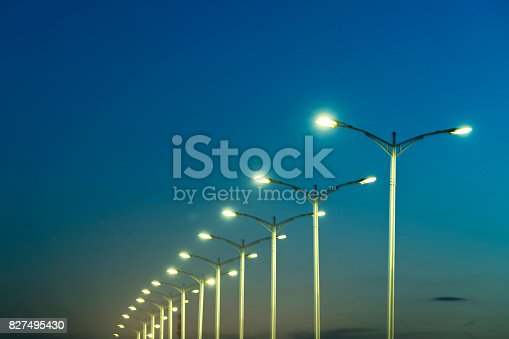 street lamps under blue sky at dusk