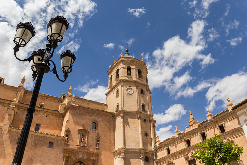 Street light and tower of the San Patricio church in Lorca