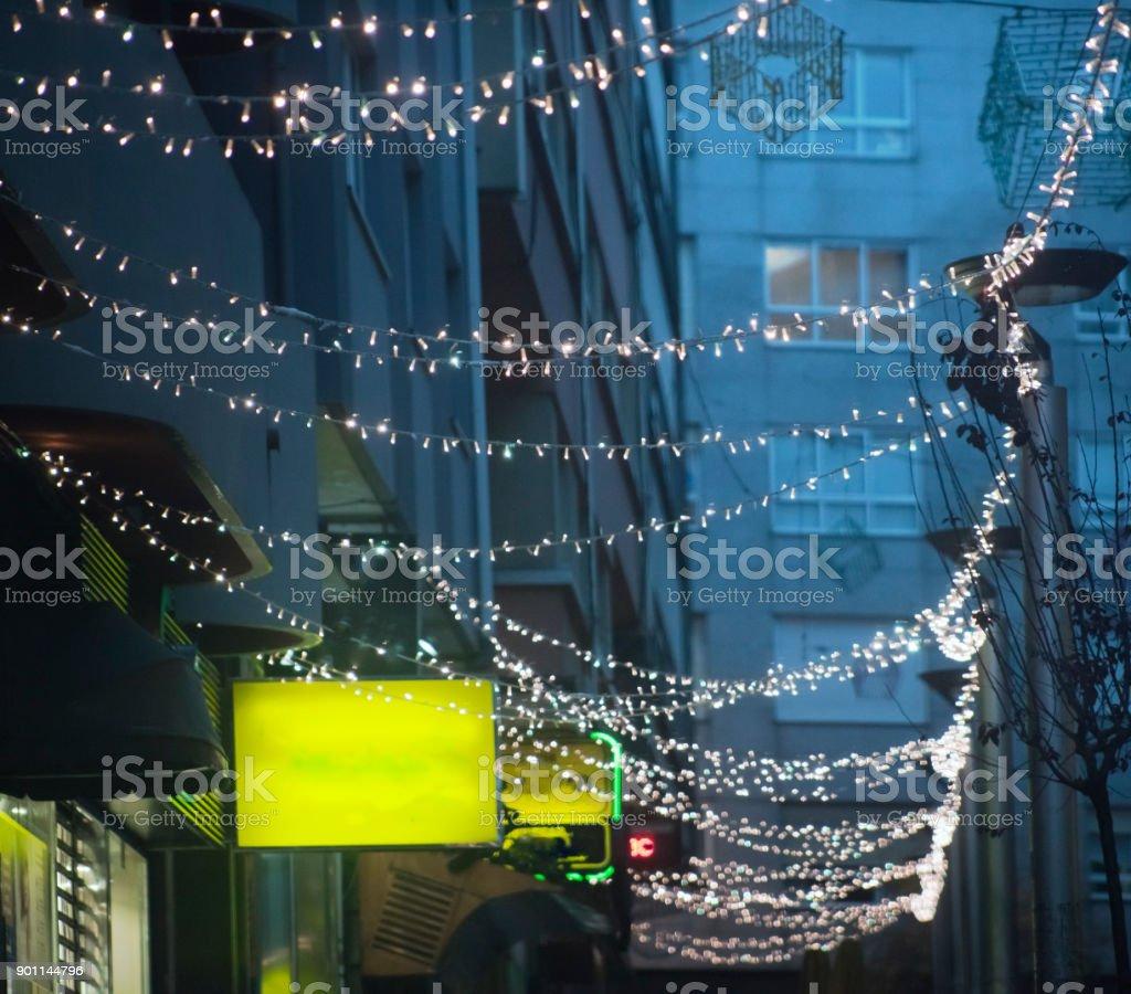 Street light Christmas decorations over sidewalk, commercial...