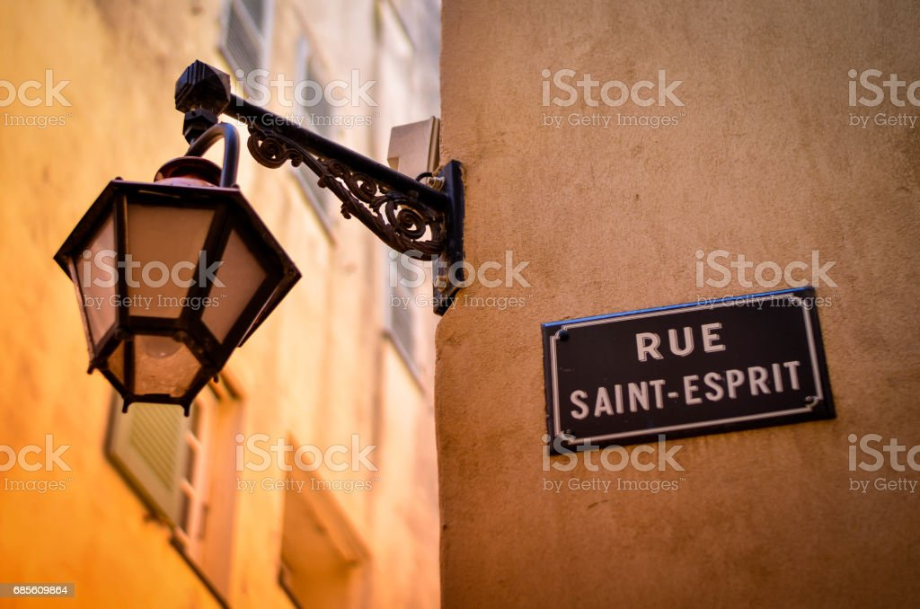 street light hanging on french narrow stock photo