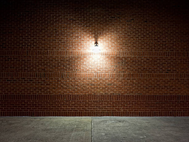 A street light on a brick wall stock photo